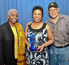 Jackie Taylor, center, accepts her award with Cheryl Lynne Bruce and Luther Goins